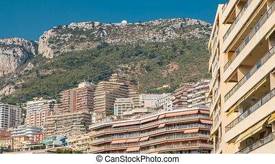 Monaco, Monte Carlo architecture on mountain hill background...