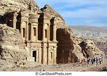 Monastery - Rock, monastery and tourists in Petra, Jordan...