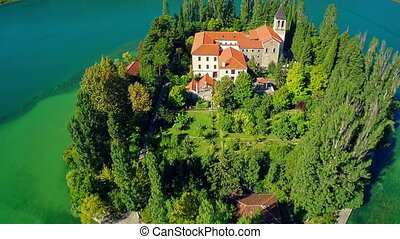 Monastery Visovac, aerial ascent shot - Copter aerial ascent...
