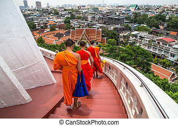 Monastic Buddhist temple, Buddhists coming up the stairs