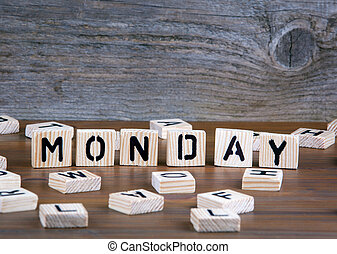 Monday from wooden letters on wooden background