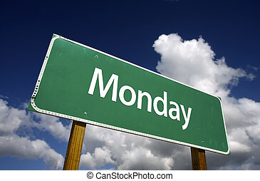 Monday Green Road Sign with dramatic blue sky and clouds - ...