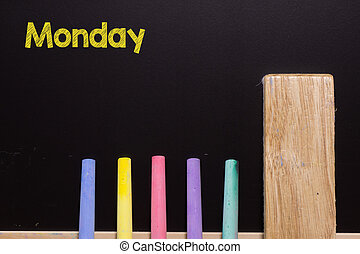 Monday on Blackboard with chalk and eraser