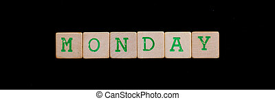 Monday spelled out in old wooden blocks