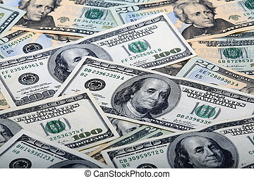 Money - $100 and $20.00 dollar bills in a graphic pattern...