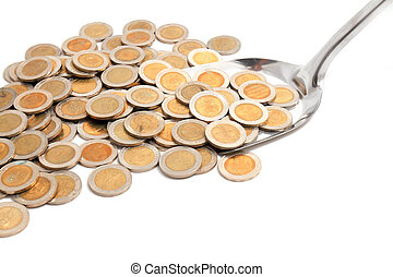Money A spoon full of coins over a white background