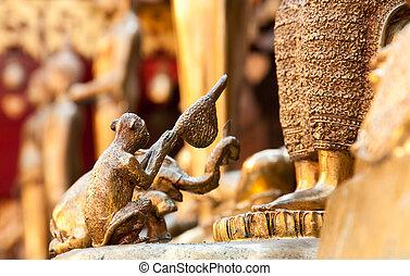 Money and elephant gave honeycomb to Buddha for worship