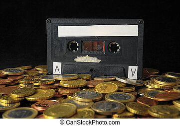 Money and Music Concept Tape Musicassette and Coins