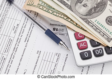 Money and pen with calculator on tax form background