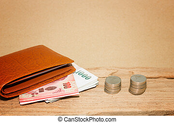 Money and purse on brown background