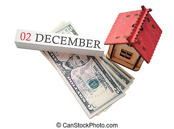 Money and red home with calendar. The concept of financial independence and the scheduled start date for December 2, winter season