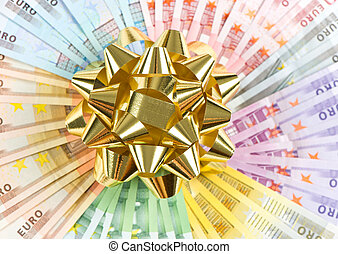 money as a gift. golden ribbon on euro banknotes