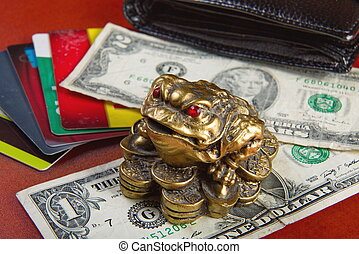 Money attracts money frog.