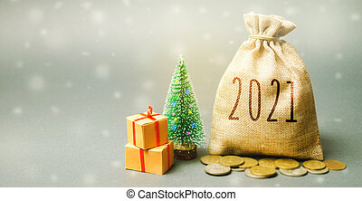 Money bag 2021, Christmas tree, and gifts. New Year or Xmas winter holiday. Accumulating money and planning a budget. Business and finance. Loans, deposit, credit. Promotions, offers