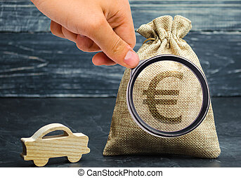 Money bag with Euro sign and miniature car. The concept of saving money to buy a car. Auto insurance. Saving. Loan repayment. Amortization. Buy a vehicle