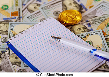 Money banknote US dollar and coins put on wooden table with silver pen, notebook and saving jar on background,