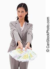 Money being offered by businesswoman