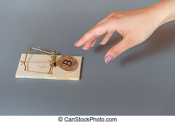 Money bitcoin in a mousetrap