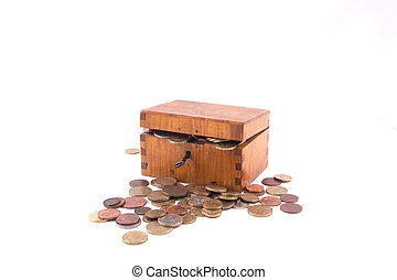 Antique handcrafted wooden money box with small money isolated on a white background