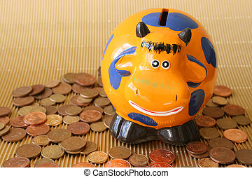 Money box in the shape of an orange cow