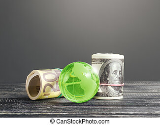 Money bundle rolls world currencies and a green glass globe. Capital investment, savings. Profit income, dividends payouts. Crowdfunding startups investing. Banking service, budget monetary policy