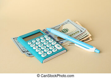 Money, calculator and pen on beige background, close up