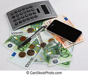 Money, calculator and smart phone