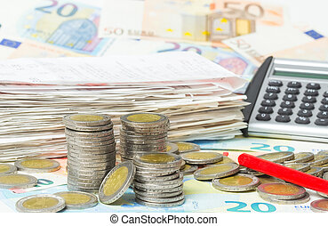 Money, cash register receipts, calculator, red pen