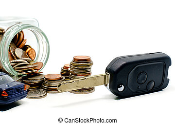 Money coins in the glass jar and car key on white background