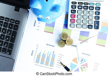 Money coins stack and business fountain pen and calculator and eyeglasses and blue piggy bank labtop with document chart on desk office backgrounds above