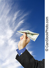 Money concept - A businessman trying to fly a paper airplane...