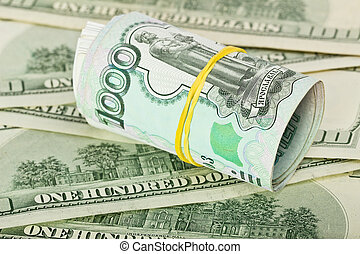 Money concept, Russian ruble against the background of dollars
