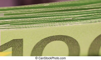 Money counter is counting one hundred euro banknotes