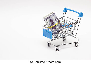 Money dollars in shopping trolley on white background, concept of buying, selling currency, valuta