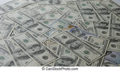 Money falling on table. Money Piles.