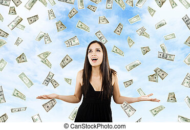 Money from Heaven - Stock image of woman standing with open...