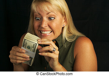 Money & Greed - Attractive Woman Excited About her Stack of...