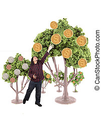 Money growing on trees - Ethnic looking man is reaching for...