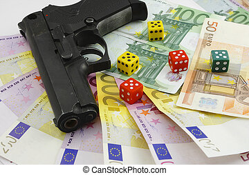 money gun and dice on the white bac