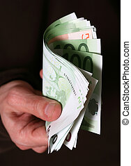 Money - Hand giving Euro banknotes money