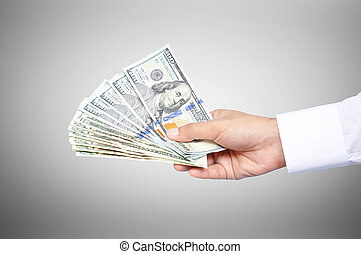 Money - hand holding United States dollar banknotes