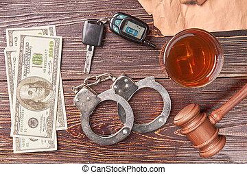 Money, handcuffs, whiskey, key, gavel.
