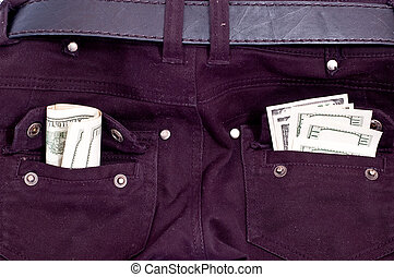 Money in back jeans pockets