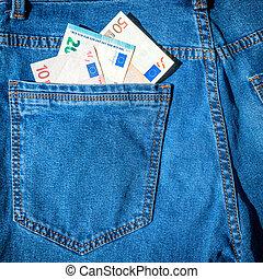 Money in blue jeans pocket