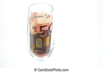 money in glass - Some money in a champagne glass isolated on...