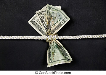money in knot - American money tied in a knot.