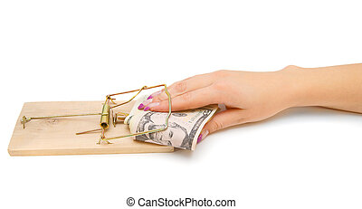 Money in mousetrap with hand.