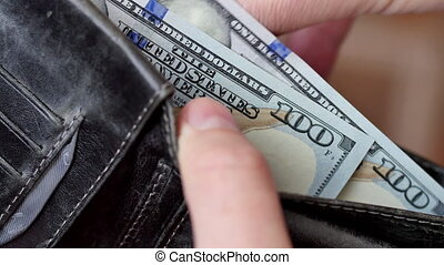 Money in the wallet. A man counting cash close-up