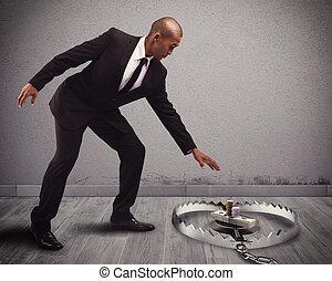 Money into a trap - Businessman takes some money into a trap