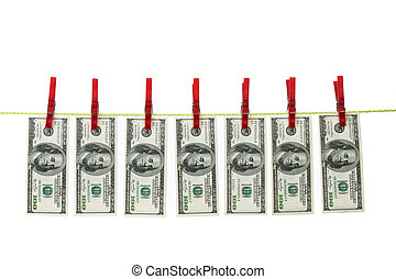 money laundering with dollars on clothes line - symbol for...